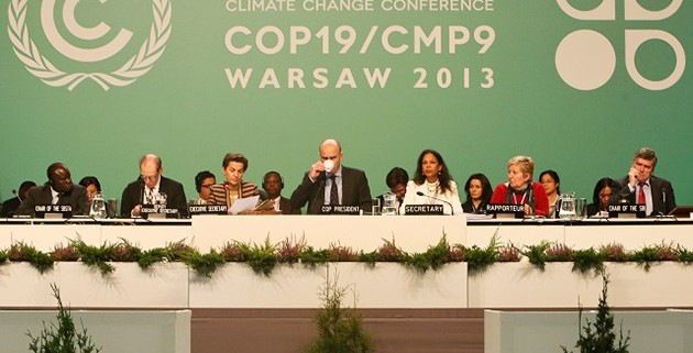 (131123) -- WARSAW, Nov. 23, 2013 (Xinhua) -- Marcin Korolec (front C), President of COP19/CMP9, and Christiana Figueres (front L3), UN Framework Convention on Climate Change (UNFCCC) Executive Secretary attend a meeting session during the 2013 UN Climate Change Conference in Warsaw, Poland, on Nov. 22, 2013. The two-week climate talks, scheduled to close on Friday, aimed to prepare for a global climate pact due to be agreed in 2015. (Xinhua/Zhang Fan)(axy)