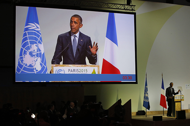 U.S. President Barack Obama addresses world leaders at the COP21, United Nations Climate Change Conference, in Le Bourget, outside Paris, Monday, Nov. 30, 2015. (AP Photo/Michel Euler)